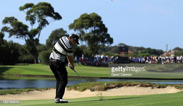 Nick Watney of the USA plays his second shot at the par 5 14th hole during day two of the 2011 Emirates Australian Open at The Lakes Golf Club on...