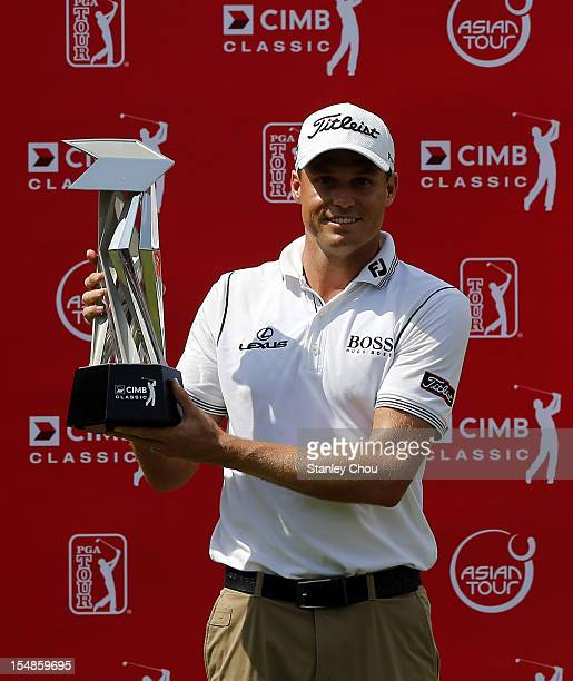 Nick Watney of USA poses with the CIMB Classic Trophy after the final round of the CIMB Classic at The MINES Resort Golf Club on October 28 2012 in...