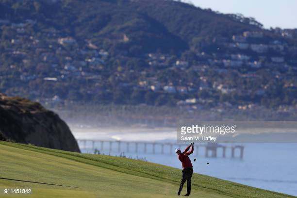 Nick Watney plays his second shot from the fairway on the fourth hole during the final round of the Farmers Insurance Open at Torrey Pines South on...