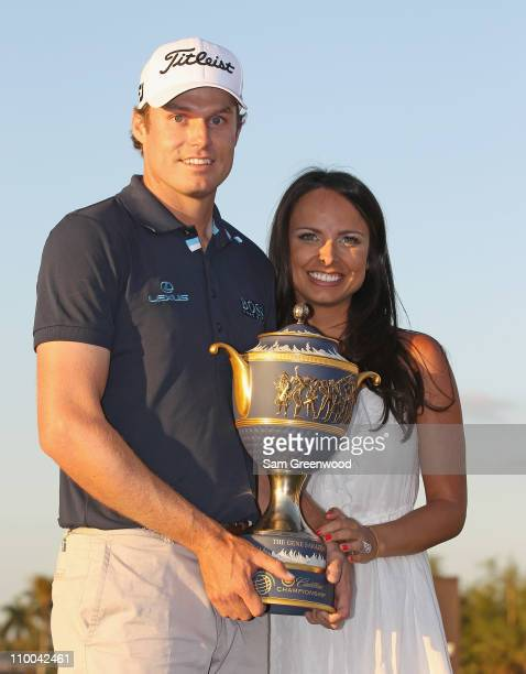 Nick Watney poses with his wife Amber and the Gene Sarazen trophy after his twostroke victory at the 2011 WGC Cadillac Championship at the TPC Blue...