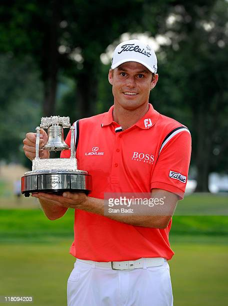 Nick Watney poses with the winner's trophy after the final round of the ATT National at Aronimink Golf Club on July 3 2011 in Newtown Square...