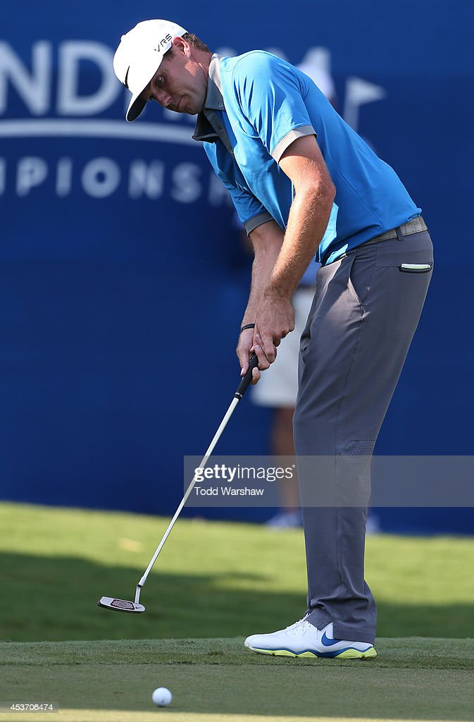 Nick Watney putts for birdie on the 18th hole during the third round of the Wyndham Championship at Sedgefield Country Club on August 16, 2014 in Greensboro, North Carolina.