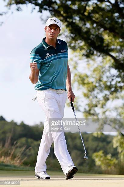 Nick Watney reacts after he made a birdie putt on the 14th hole green during the final round of The Barclays at the Black Course at Bethpage State...