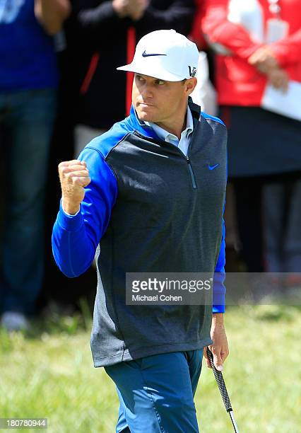 Nick Watney reacts to a birdie putt on the 17th green during the Final Round of the BMW Championship at Conway Farms Golf Club on September 16 2013...