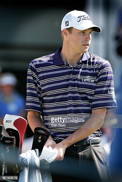 Nick Watney selects a club at the first tee during the final round of the Mercedes-Benz Championship at the Plantation Course at Kapalua on January...