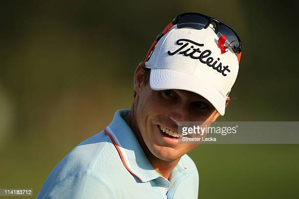 Nick Watney smiles as he waits on the practice ground during the third round of THE PLAYERS Championship held at THE PLAYERS Stadium course at TPC...