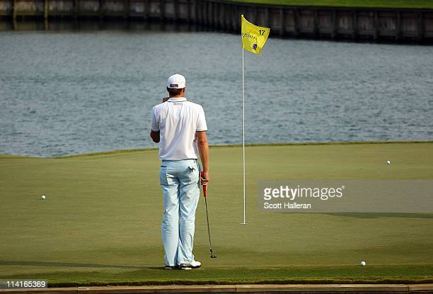 Nick Watney waits on the 17th hole during the second round of THE PLAYERS Championship held at THE PLAYERS Stadium course at TPC Sawgrass on May 13...