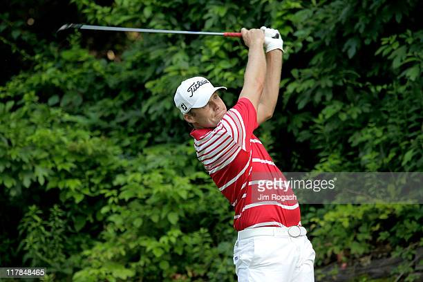 Nick Watney watches his shot from the 15th tee box during round three of the Travelers Championship at TPC River Highlands on June 25 2011 in...