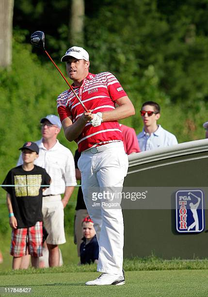 Nick Watney watches his shot from the 18th tee box during round three of the Travelers Championship at TPC River Highlands on June 25 2011 in...