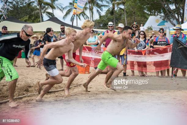 Nick Wecker Ryan Blenkinship and Daniel Crameri compete during the Darwin Beer Can Regatta at Mindil Beach on July 9 2017 in Darwin Australia The...