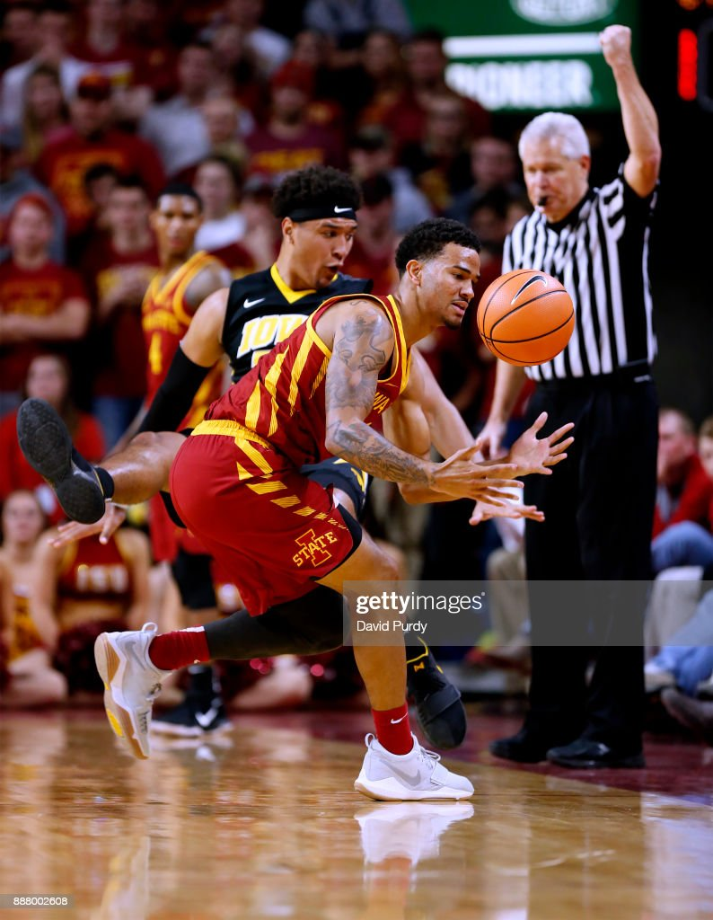 Nick Weiler-Babb #1 of the Iowa State Cyclones battles for the ball with Cordell Pemsl #35 of the Iowa Hawkeyes in the second half of play at Hilton Coliseum on December 7, 2017 in Ames, Iowa. The Iowa State Cyclones won 84-78 over the Iowa Hawkeyes.