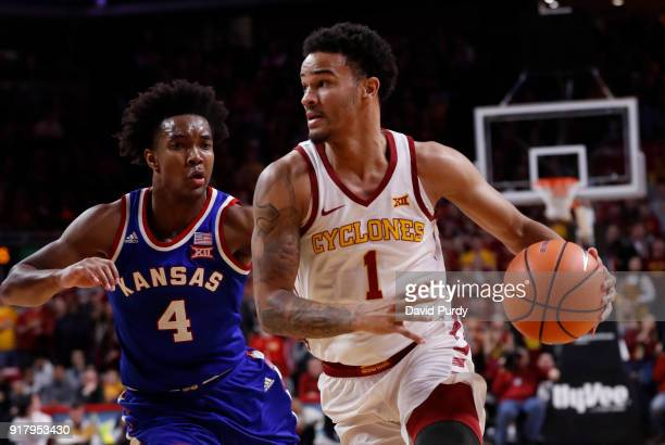 Nick WeilerBabb of the Iowa State Cyclones drives the ball as Devonte' Graham of the Kansas Jayhawks defends in the first half of play at Hilton...