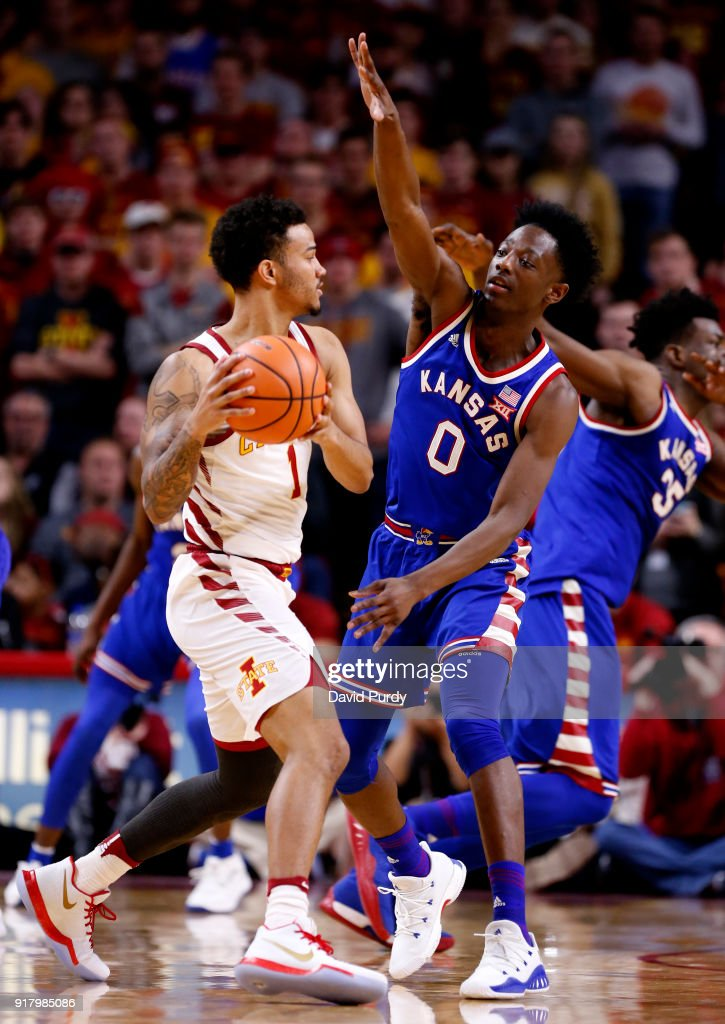 Nick Weiler-Babb #1 of the Iowa State Cyclones looks to pass as Marcus Garrett #0 of the Kansas Jayhawks puts pressure on in the second half of play at Hilton Coliseum on February 13, 2018 in Ames, Iowa. The Kansas Jayhawks won 83-77 over the Iowa State Cyclones.