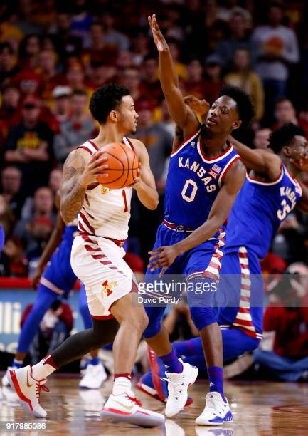Nick WeilerBabb of the Iowa State Cyclones looks to pass as Marcus Garrett of the Kansas Jayhawks puts pressure on in the second half of play at...