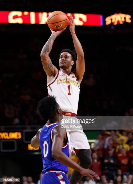 Nick WeilerBabb of the Iowa State Cyclones takes a three point shot as Marcus Garrett of the Kansas Jayhawks defends in the first half of play at...