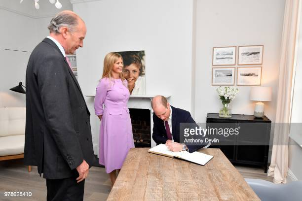 Nick WentworthStanley and Clare Milford Haven lookon as The Duke of Cambridge signs the guest book during a visit to James' Place in Liverpool on...