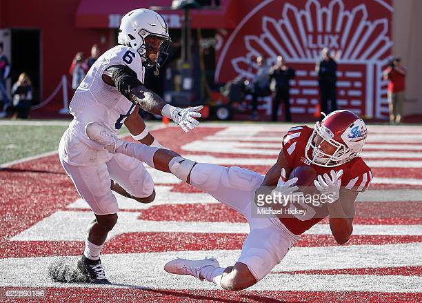 Nick Westbrook of the Indiana Hoosiers catches a touchdown pass in the end zone as Malik Golden of the Penn State Nittany Lions defends at Memorial...