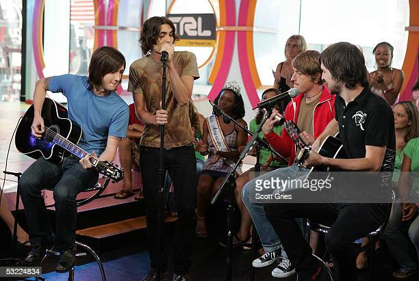 Nick Wheeler Tyson Ritter Chris Gaylorand Mike Kennerty of The AllAmerican Rejects perform onstage during MTV's Total Request Live at MTV Studios...