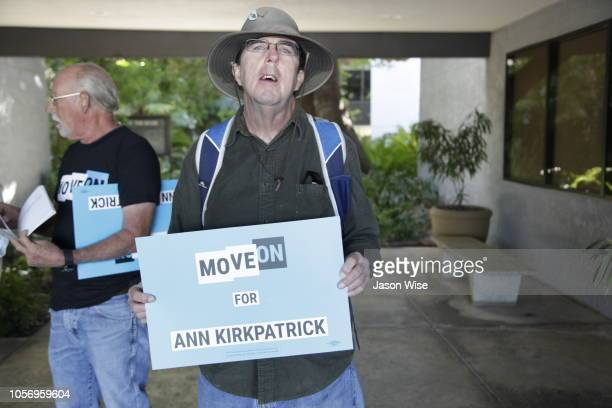 Nick White of MoveOn holds a sign in support of Ann Kirkpatrick on November 3 2018 in Tucson Arizona