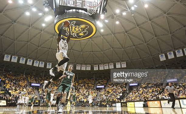 Nick Wiggins of Wichita State dunks against the College of William and Mary during the first half on Thursday Nov 14 at Koch Arena in Wichita Kan