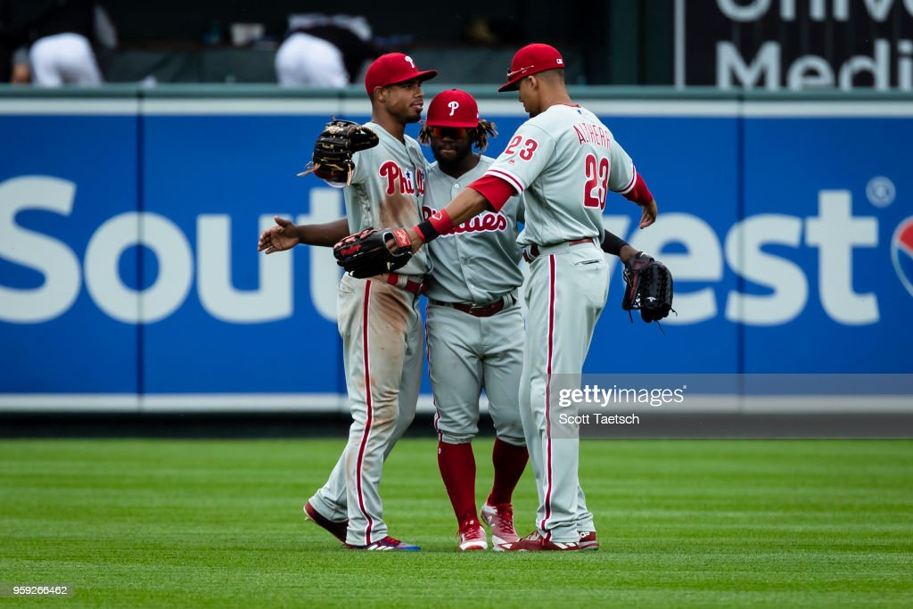 Nick Williams #5, Aaron Altherr #23, and Odubel Herrera #37 of the Philadelphia Phillies celebrate after the game against the Baltimore Orioles at Oriole Park at Camden Yards on May 16, 2018 in Baltimore, Maryland. Phillies won 4-1.