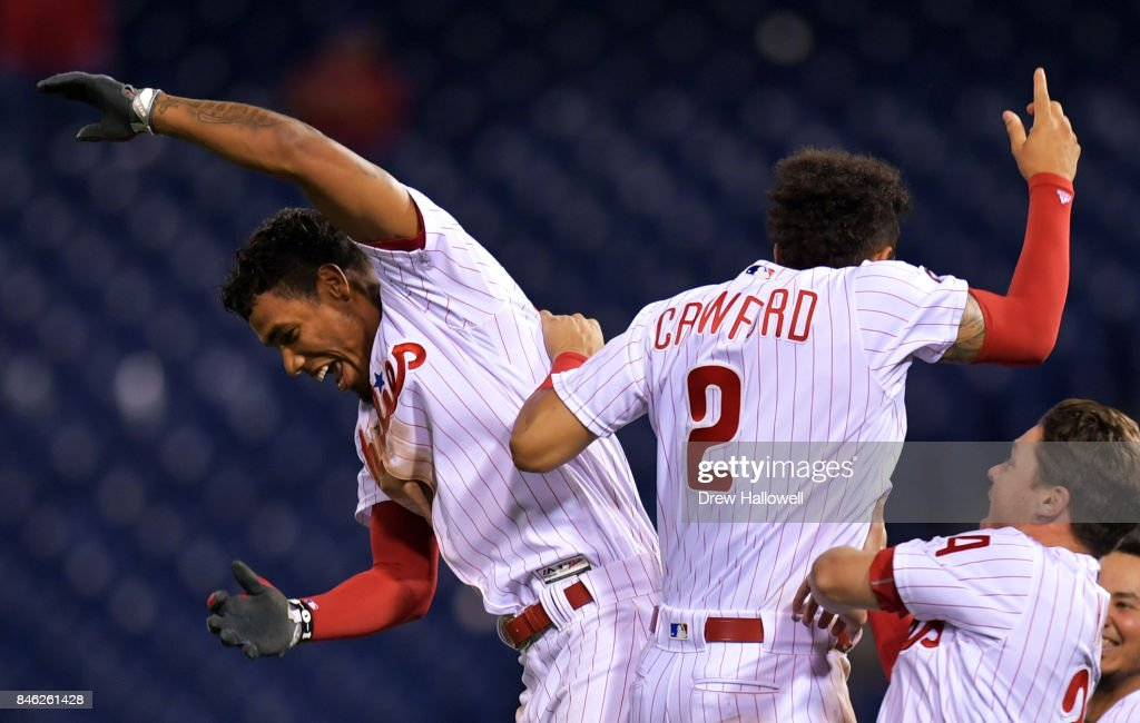 Nick Williams #5, J.P. Crawford #2 and Andrew Knapp #34 of the Philadelphia Phillies celebrate Williams' walk off RBI double in the 15th inning against the Miami Marlins at Citizens Bank Park on September 12, 2017 in Philadelphia, Pennsylvania. The Phillies won 9-8.
