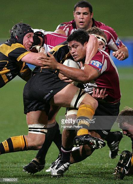 Nick Williams of North Harbour is tackled by Courtney MacKay of Taranaki during the Air New Zealand Cup match between North Harbour and Taranaki at...