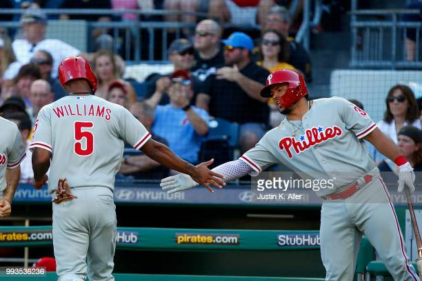 Nick Williams of the Philadelphia Phillies celebrates with Jorge Alfaro after scoring on a RBI single in the seventh inning against the Pittsburgh...