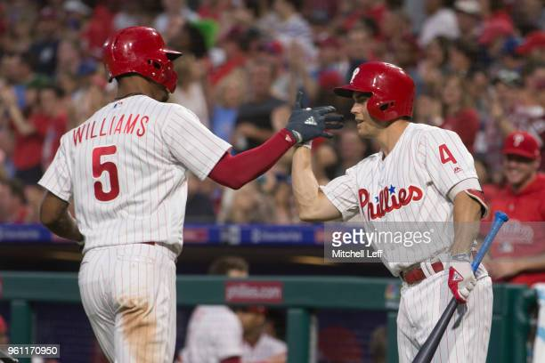 Nick Williams of the Philadelphia Phillies high fives Scott Kingery after hitting a solo home run in the bottom of the fourth inning against the...