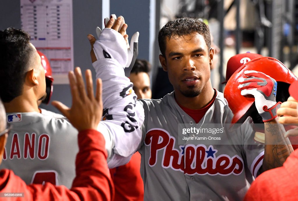 Nick Williams #5 of the Philadelphia Phillies is greeted in the dugout after a solo home run in the seventh inning of the game against the Los Angeles Dodgers at Dodger Stadium on May 30, 2018 in Los Angeles, California.
