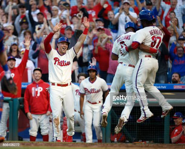 Nick Williams of the Philadelphia Phillies jumps into the arms of Odubel Herrera as he and Rhys Hoskins score on Williams threerun inside the park...