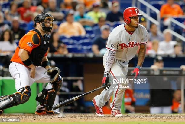 Nick Williams of the Philadelphia Phillies watches his gamewinning RBI in the 12th inning in front of AJ Ellis of the Miami Marlins at Marlins Park...