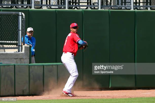 Nick Williams of the Phillies makes a catch along the foul line and sets up to throw the ball back into the infield during the spring training...