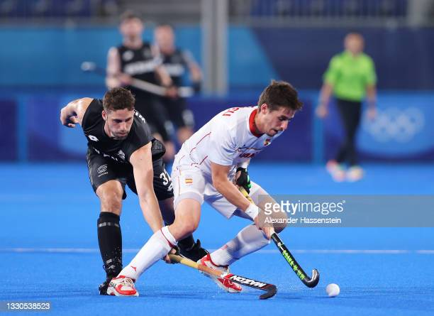 Nick Wilson of Team New Zealand attempts to tackle Josep Romeu Argemi of Team Spain during the Men's Preliminary Pool A match between Spain and New...