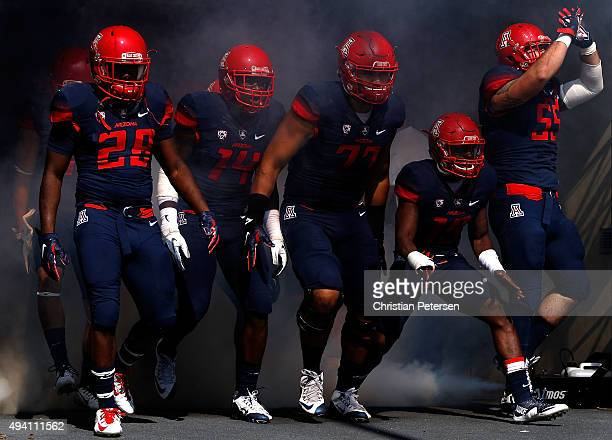 Nick Wilson Paul Magloire Jr #14 Lene Maiava DaVonte' Neal and Jeff Worthy of the Arizona Wildcats take the field during introductions to the college...