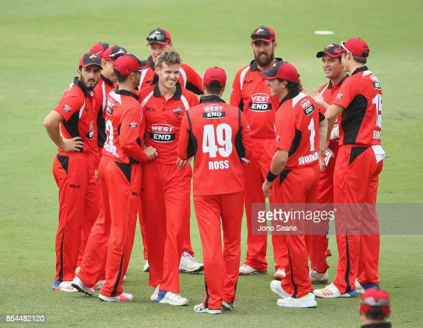 Nick Winter celebrates his wicket with team mates during the JLT One Day Cup match between South Australia and the Cricket Australia XI at Allan...