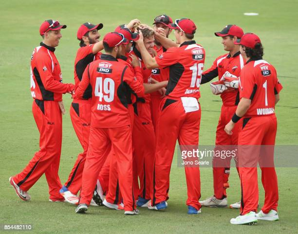 Nick Winter of SA celebrates his wicket with team mates during the JLT One Day Cup match between South Australia and the Cricket Australia XI at...