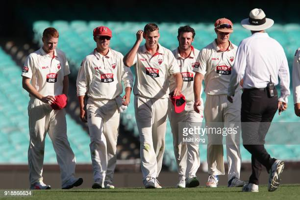 Nick Winter of the Redbacks celebrates with team mates after taking five wickets during day one of the Sheffield Shield match between New South Wales...