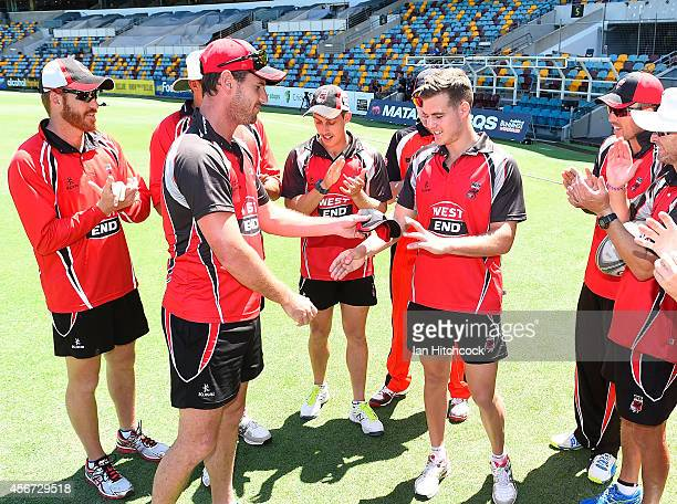 Nick Winter of the Redbacks is presented with his cap by Shaun Tait before his debut match during the Matador BBQs One Day Cup match between Victoria...