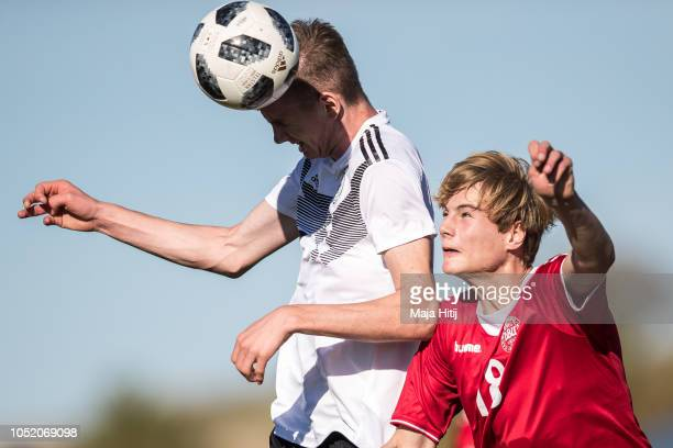 Nick Woltemadel of Germany wins a header against Mathias Brems of Denmark during the Germany U17 against Denmark U17 International Friendly match on...