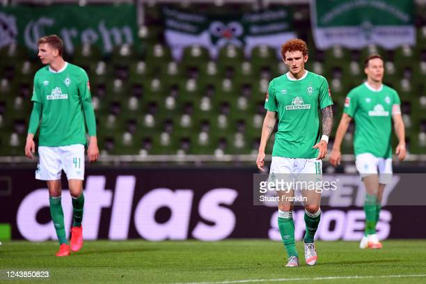 Nick Woltenmade and team mate Joshua Sargent of SV Werder Bremen look on dejected after conceding a third goal during the Bundesliga match between SV...