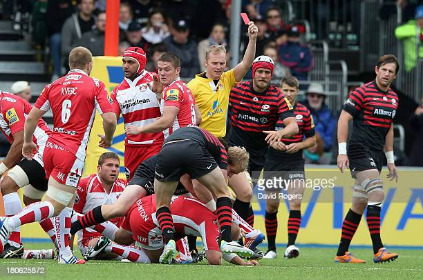 Nick Wood of Gloucester is shown the red card in the first minute by referee Wayne Barnes during the Aviva Premiership match between Saracens and...