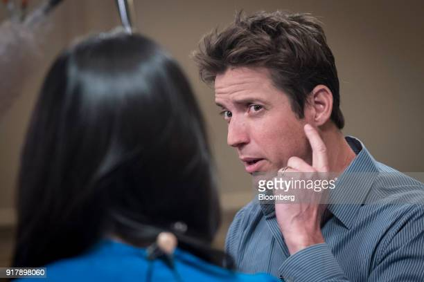 Nick Woodman founder of extreme sports camera maker GoPro Inc gestures while speaking during a Bloomberg Television interview at the Goldman Sachs...