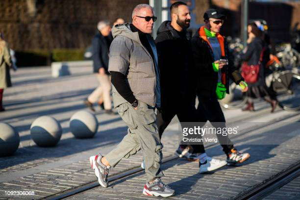 Nick Wooster is seen wearing grey jacket with short sleeves pants black turtleneck Nike sneakers during the 95th Pitti Uomo at Fortezza Da Basso on...