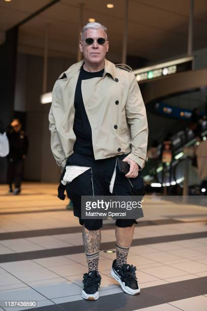 Nick Wooster is seen wearing taupe coat black shorts and black/white sneakers during the Amazon Fashion Week TOKYO 2019 A/W on March 21 2019 in Tokyo...