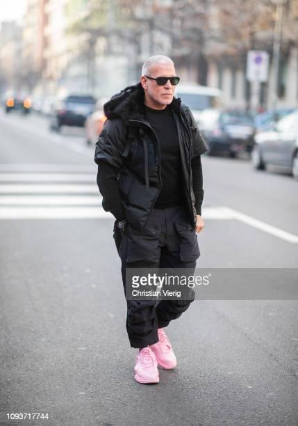 Nick Wooster wearing black jacket, pants, pink Nike sneaker is seen outside Sunnei during Milan Menswear Fashion Week Autumn/Winter 2019/20 on...