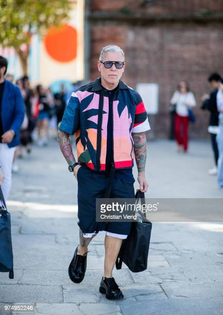 Nick Wooster wearing jacket with palm tree print shorts is seen during the 94th Pitti Immagine Uomo on June 14 2018 in Florence Italy