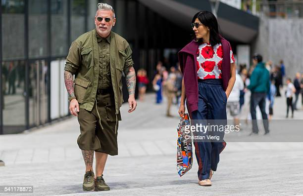 Nick Wooster wearing military shorts jacket and button shirt outside Canali during the Milan Men's Fashion Week Spring/Summer 2017 on June 18 2016 in...