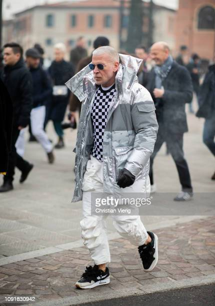 Nick Wooster wearing silver down feather coat is seen during the 95th Pitti Uomo at Fortezza Da Basso on January 09 2019 in Florence Italy