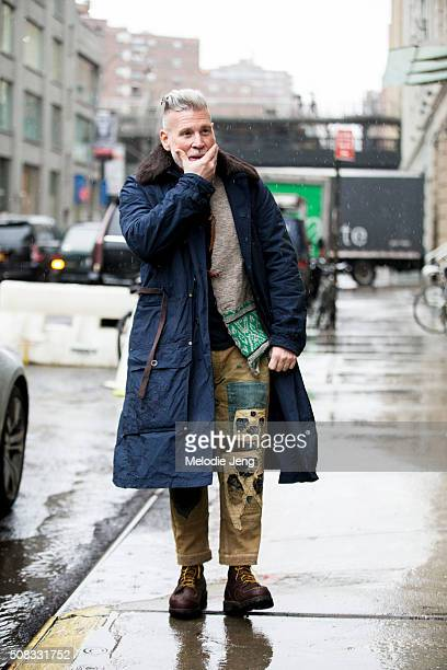 Nick Wooster wears a blue parka with a fur lining and khaki pants with vintage/Japanese style denim patchwork during New York Fashion Week Men's...